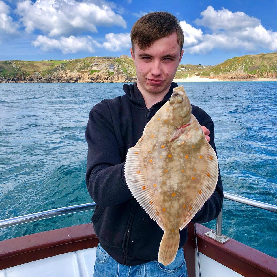 Devon with a Plaice whilst fishing on Lo Kie Adventures