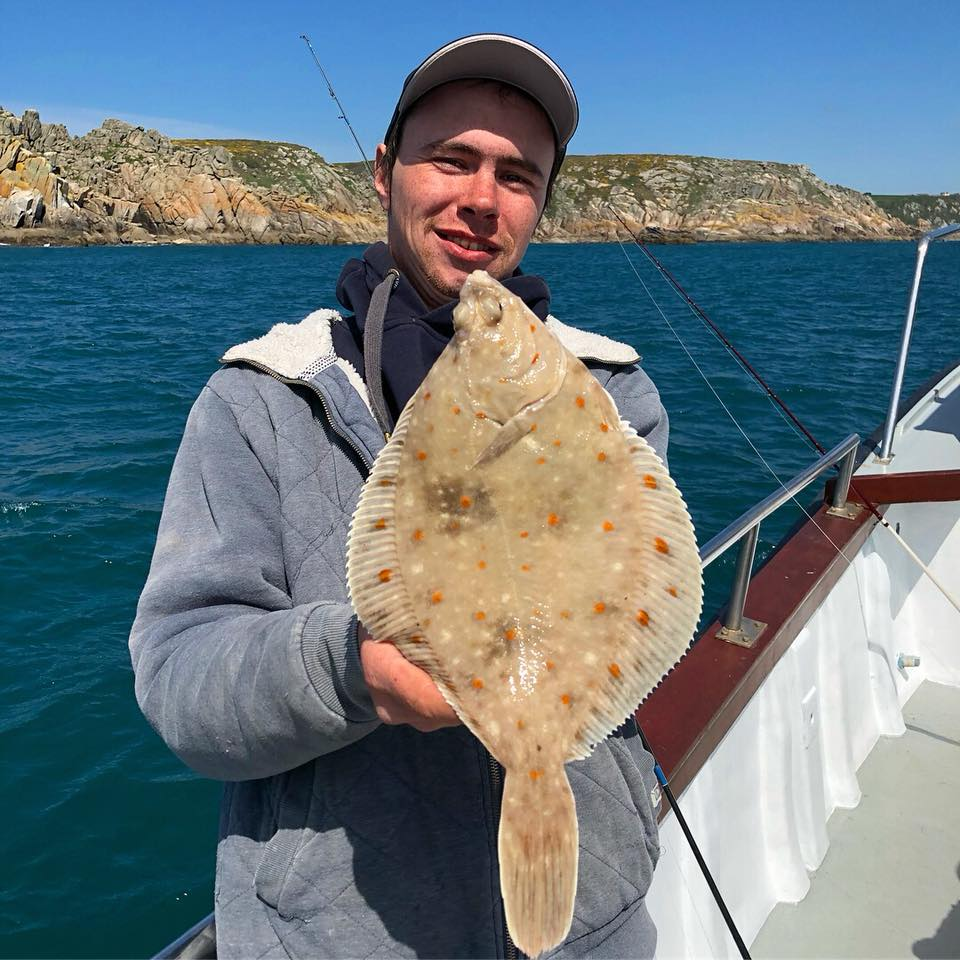 Kevin with a Plaice on Lo Kie Adventures Fishing trips
